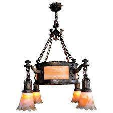 arts and crafts chandelier with hammered finish center bowl and bournique shades