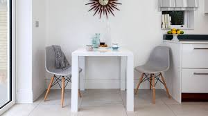 2 seater white gloss dining table and eames chairs