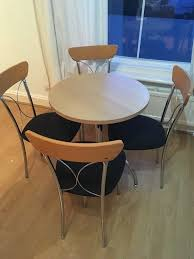 wood round dining table and 4 chairs table diameter approx 60cm ideal if