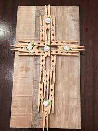 make a cross to hang on your wall using a variety of supplies provided