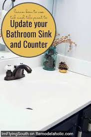 painted bathroom sink makeover i m flying south featured on remodelaholic diy