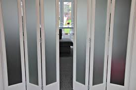 internal folding sliding door systems marston white 6 leave frosted glass