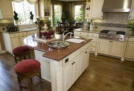 a curved kitchen island visually softens the hard lines of a boxy kitchen its off white finish twisted rope detail and rich granite top make this island a