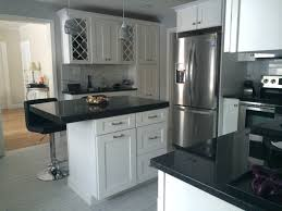 White cabinets with Angola Black granite counters