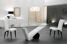 dining table design with glass top. glass top in combination with white marble looks amazing. this contemporary take on dining table is perfect for those who like modish look. design