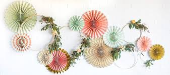 you can attach them to a wall and add other elements such as hoops and greenery to achieve stunning displays this display uses trend and mint party fans