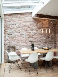 industrial style dining room lighting. Beautiful Industrial An Industrial Dining Space With Skylights Is Filled Daylight With Industrial Style Dining Room Lighting A