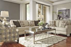 ashley furniture living room sets with two elegant lamp and glass table