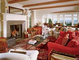 comfortable sofas and chairs are mixed with european antiques in the great room of a lakefront