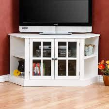 interior white wooden tv stand with shelves and doors on brown wooden floor fascinating