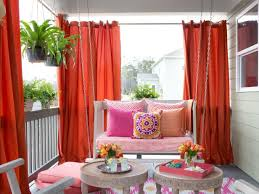 vibrant outdoor space with hanging daybed and dries