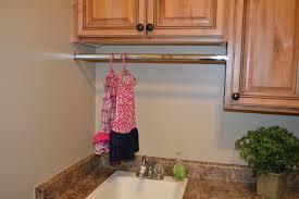 custom closet rod in the laundry room