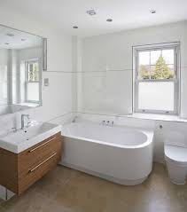 bathroomtub gettyimages 175597537 596ea3f5685fbe001133ede7 how long does a refinished tub last from bathtub reglazing safety
