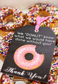 this easy and tasty gift is sure to be a hit with your coworkers you can some donuts and individually wrap them up you can then make a to attach