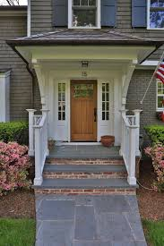 How to Decorate Brick Front Porches : Modern Home Exterior Design With  Single Brown Wooden Door And White Glassed Panel Sides Combine With Cream  Siding And ...