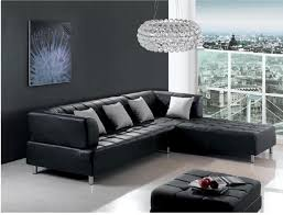 modern living room with black leather sofa black wall and luxury crystal hanging lamp