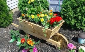 wood pallet wheelbarrow planter for garden