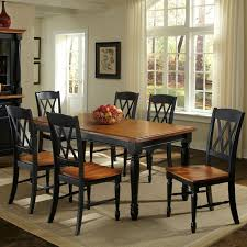 home styles monarch 7 piece dining table with 6 double x back chairs black oak dining table sets at hayneedle