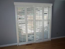 french exterior traditional white wooden frame plantation shutters for sliding glass patio door placed on gray blind shades sliding glass