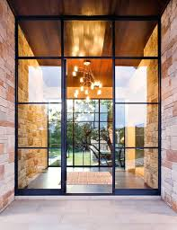 contemporary glass front doors oaks contemporary house front door interiors continuous stone wall leads contemporary glass