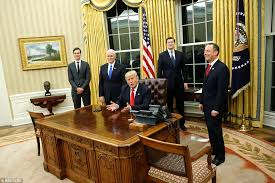 president oval office. the president was enthusiastic as he signed orders on friday evening before making his way oval office i