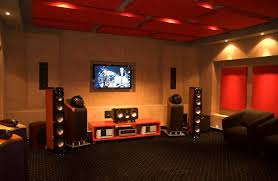 attractive small home theater room design ideas red basement ceiling modern tv wall unit armchair furniture simple wall lighting brown laminate flooring