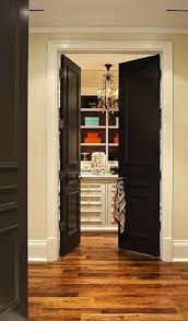 design closet in french walk in closet with black paneled french doors closet island glass door