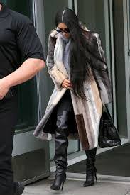 kim kardashian s multi color fur coat hooded sweatshirt and over the