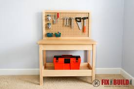 a kids workbench with pegboard and shelf