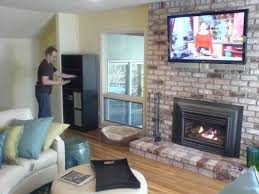 fireplace decor with tv to mount a tv over brick fireplace and hide the wires stunning