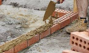 laying the next courses of bricks