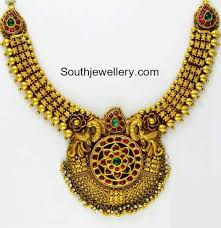 antique gold necklace with peacock pendant