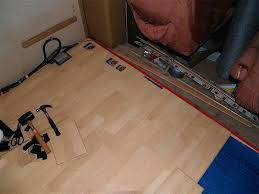 installing laminate flooring over concrete laying down the laminate