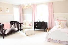 pink nursery furniture. pure white mixed with subtle splashes of pink in this large nursery unify the look furniture y