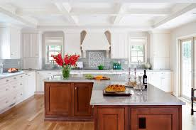 Example of a large classic l-shaped medium tone wood floor open concept  kitchen design