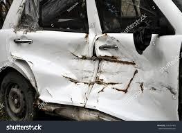 broken old white car door closeup on the street