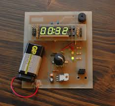 rotary encoder based cooking timer the schematic is fairly straightforward a pic18f2525 sits in the middle connected to the rotary encoder gray code and button 3 indication leds and a