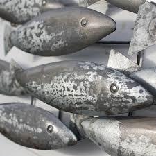 metal fish school tin fish coastal