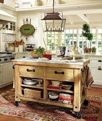 pottery barn kitchen island dark wood dining table wicker dining chairs faux stone backsplash glass mullion