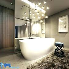 chandelier over tub intricate in bathroom