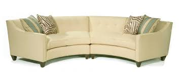 Another two-piece sectional with button tufted backing, this soft yellow  sofa stands over .