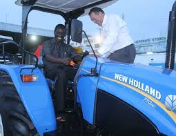 agricultural society of kenya kisumu branch chairperson caleb ogua and cmc motors ceo mark johnson at the new holland tt4 launch