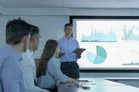 Presentation Charts And Graphs Free Businessman Making Presentation Using Screen Of Charts And Graphs In D943_247_853