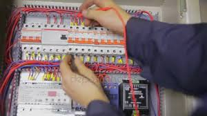 electrician working with circuit breaker, tester, multimeter at a how do old fuse boxes work electrician working with circuit breaker, tester, multimeter at a fuse box stock