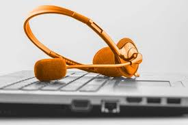 best essays review uk bestessays com reviews a customer service headset on top of a laptop