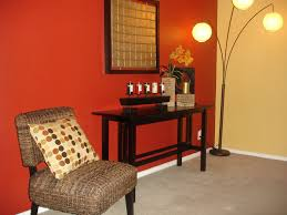 interior: Pleasant Lounge Space With Bold Orange Accents Wall Color Filled  With Brown Chair And