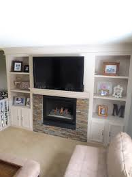 built in shelving around a fireplace remodel construction2style on remodelaholic