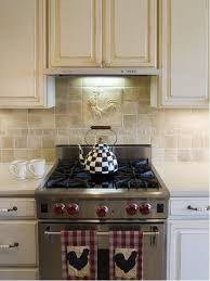 french country kitchen tile backsplash. example of a classic kitchen design in other with stainless steel appliances, raised-panel french country tile backsplash i