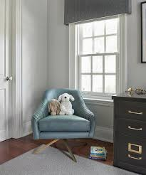 blue leather swivel chair on gray rug