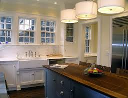 kitchen design with er yellow walls paint color white kitchen cabinets with calcutta marble counter tops blue kitchen island with butcher block